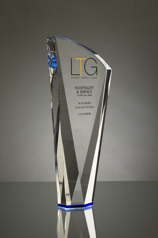 A studio photograph of a Crystal Galleries award shot on a grey backgroung with a horizon line behind the award.