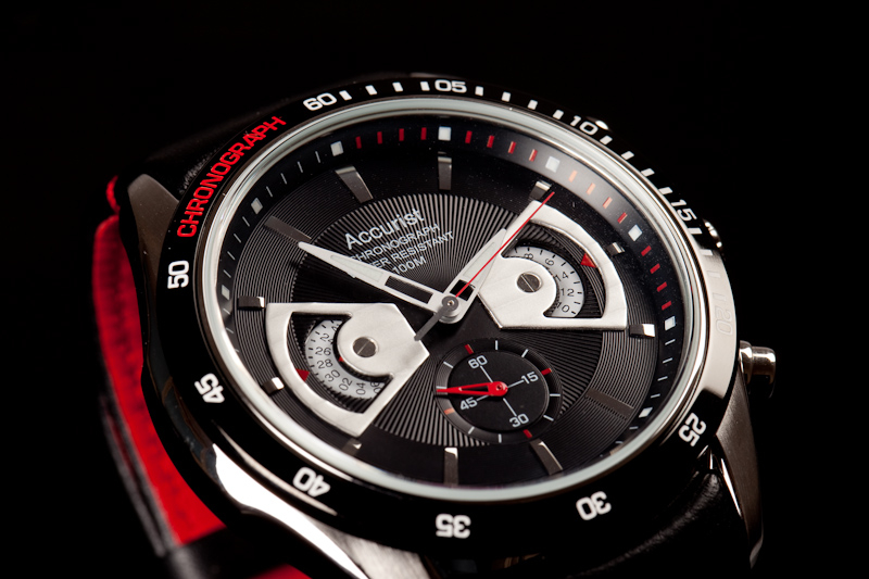 This a studio style photograph shot by Cal Carey, it is a detail shot of the watches mechanics and its clean design.