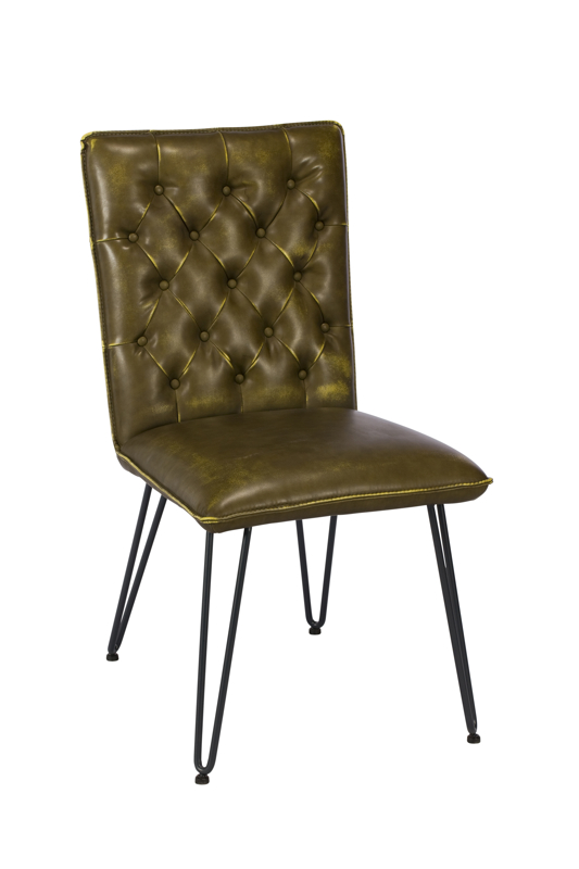 A photograph of a living room chair made of steel and leather, furniture photography by Cal Carey Photography