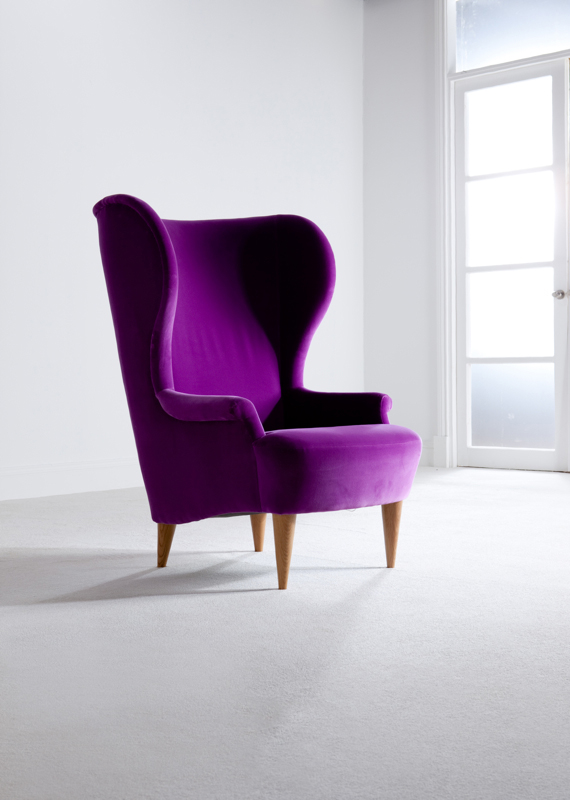 A purple Barker & Stonehouse armchair, lamp and sofa in a light room set.
