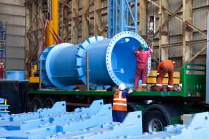 Photograph of a piece of engineered piping been loaded onto a lorry for transportation in a warehouse. Aquatic provide a comprehensive range of modular powered reel and tensioner ... Subsea Communities is the Acteon group's knowledge sharing forum. Shot by Cal Carey industrial photographer based in the north east UK.