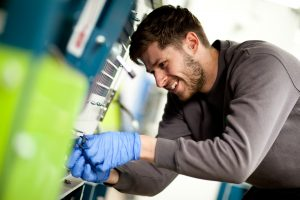 This is a corporate shot of a suited Greenbank employee working in an work setting in Middlesbrough, Teeside.