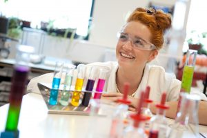 Professional advertising shot showing a young student enjoying, what looks like, a chemistry lesson. Shot by professional northeast advertising photographer Cal Carey.